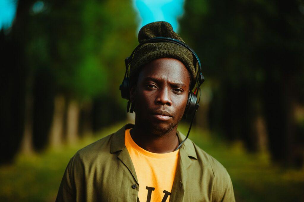 man in brown zip up jacket wearing black headphones